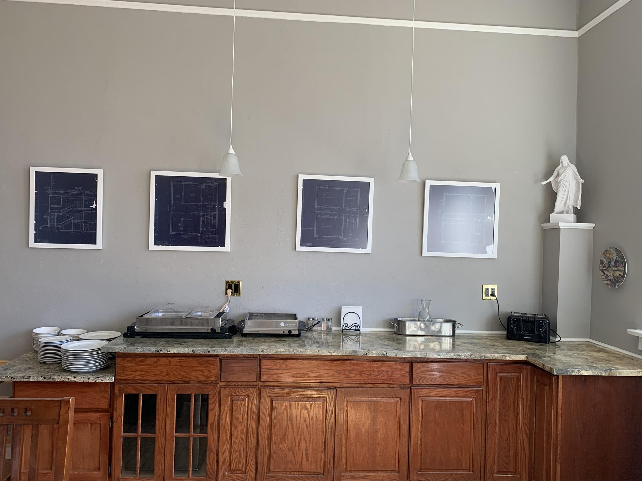 Dining Room wall with blueprints hanging
