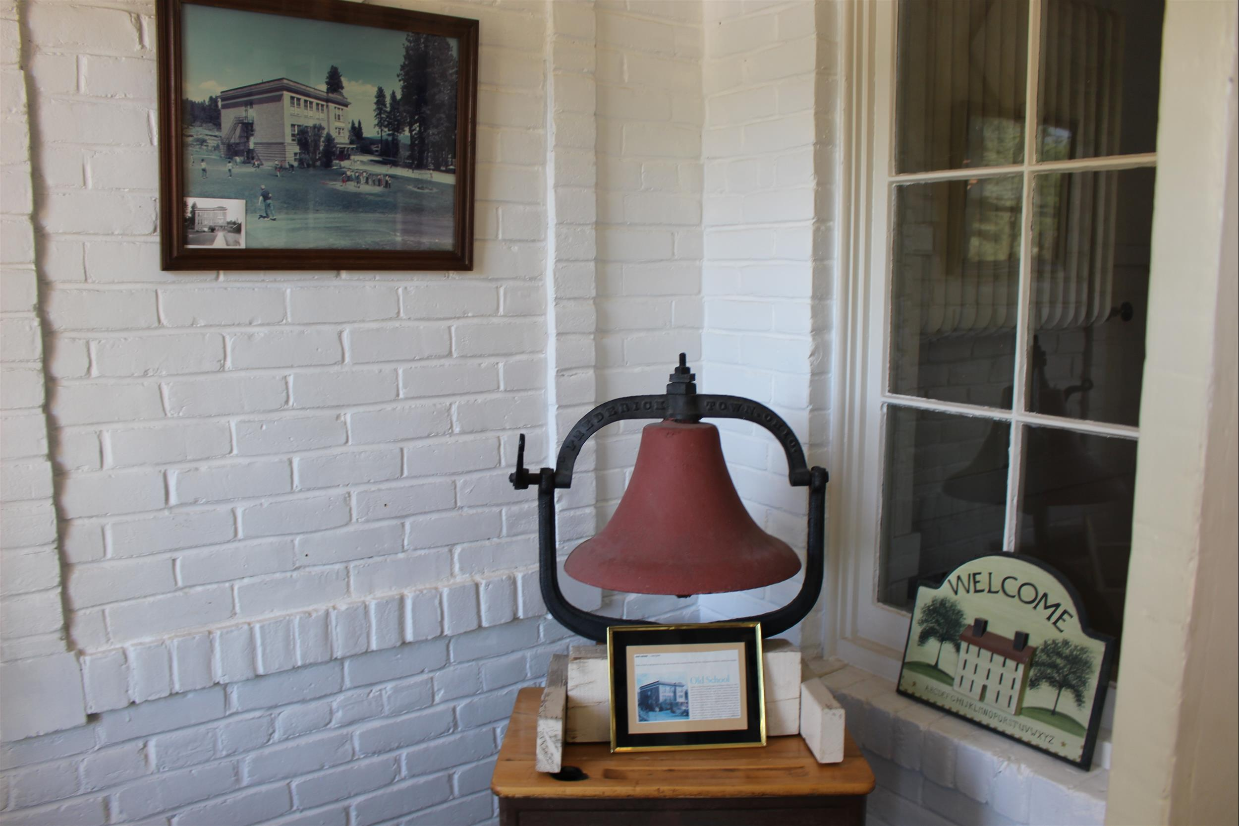 old school bell and photo of school house